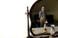 Don Campbell / H-P staff Lloyd Dalager, president of the House of David, is reflected in a mirror as he looks over one of the bedrooms that needs renovation, Wednesday, October 4, 2006, in the Shiloh