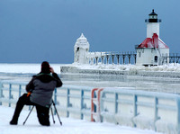 Don Campbell / H-P staff Dan Sheehan, from St. Joseph, photographs the St. Joseph Lighthouse Monday, February 11, 2008,